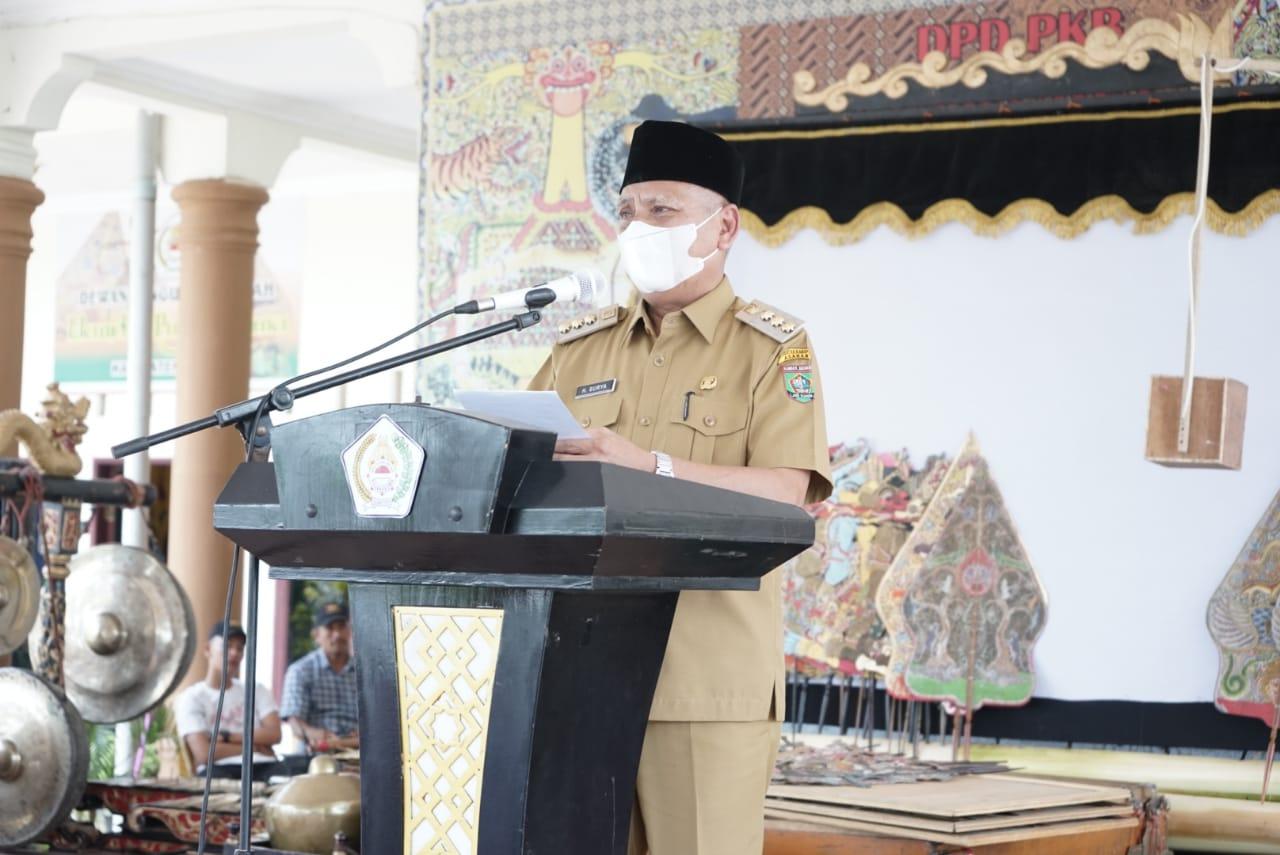 Bupati Asahan, H Surya BSc saat sambutan pada peresmian Musala Pujakesuma